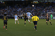 5/22/15- NYCFC midfielder A. Jacobson fights for a header during a NYCFC home match played at Yankee Stadium in the south Bronx.