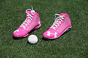 LOS ANGELES, CA - MAY 12:  A pair of pink cleats and a baseball with pink seams lie on the grass ready for use in honor of Mother's Day at the Los Angeles Dodgers game against the Miami Marlins on Sunday, May 12, 2013 at Dodger Stadium in Los Angeles, California. The Dodgers won the game 5-3. (Photo by Paul Spinelli/MLB Photos via Getty Images)
