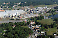 Alcoa began producing aluminum in Badin, NC in 1916 at Alcoa Badin Works. The town was built to sustain the company and four Yadkin River dams, were built to support the electric needs of Alcoa's Badin Works. The plant was closed in 2007. At issue now is whether Alcoa can still oeprate the dams and generate power,  given that it is no longer providing jobs for the people of Badin and Stanly County. In November, 2010 NC regulators revoked Alcoa's certification to operate dams along the Yadkin River. The NC Dept of Environment and Natural Resources claimed that Alcoa failed to displose water quality details. The withdrawal of certification would essentially block Alcoa's bid to get federal apporoval (FERC) to operate four dams for up to 50 more years.