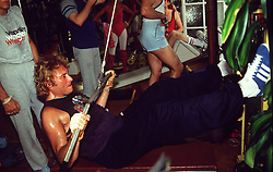 File photo : File photo of French singer and actor Johnny Hallyday (born Jean-Philippe Smet; 15 June 1943) pictured in June 1990 . France's biggest rock star Johnny Hallyday has died from lung cancer, his wife says. He was 74. The singer - real name Jean-Philippe Smet - sold about 100 million records and starred in a number of films. Photo by Calo-MF/ABACAPRESS.COM