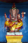 Ganesh on a yellow pedestal.