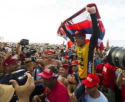 December 18, 2017 - Oahu, Hawaii, U.S. - John John Florence of Hawaii is carried after winning the World Surf League World Title during the Billabong Pipe Masters. (Credit Image: © Erich Schlegel via ZUMA Wire)