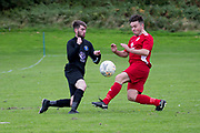 Charlies Accies (red) v Occidental (black) in the Dundee Saturday Morning Football League at Drumgeith