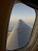wing of a passenger airplane in flight seen from window