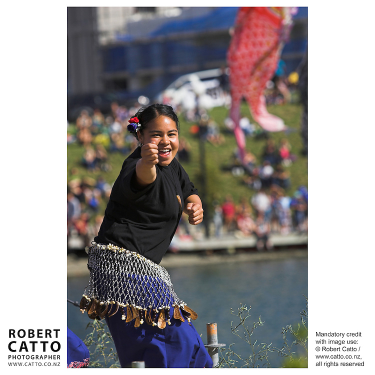 A group of Tokelauan performers excite the crowd at Frank Kitts Park on Wellington's waterfront, as part of the free outdoor annual Summer City Festival.