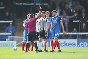 RED CARD Ian Henderson is sent off for a challenge on Gwion Edwards during the EFL Sky Bet League 1 match between Peterborough United and Rochdale at London Road, Peterborough, England on 14 April 2018. Picture by Daniel Youngs.