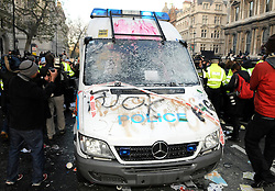 © under license to London News Pictures. 21/11/2010 The police van vandalized today (Wed) Thousands of students join the rally in Central London against the coalition Government's proposed fees and cuts.   Picture credit should read Grant Falvey/London News Pictures