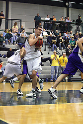30 December 2006: Andrew Freeman muscles in a rebound. The Titans outscored the Britons by a score of 94-80. The Britons of Albion College visited the Illinois Wesleyan Titans at the Shirk Center in Bloomington Illinois.<br />