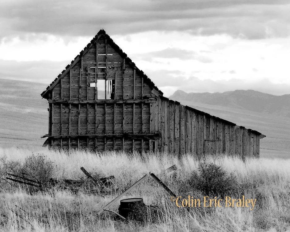 An abandoned barn sits in a field in northern Utah.