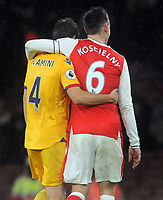 Football - 2016 / 2017 Premier League - Arsenal vs. Crystal Palace<br /> <br /> Ex Arsenal player, Mathieu Flamini of Crystal Palace and Laurent Koscielny of Arsenal leave the field arm in arm at The Emirates.<br /> <br /> COLORSPORT/ANDREW COWIE