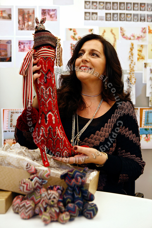 Angela Missoni, owner of the Italian fashion house based in Varese and famous for its unique knitwear, made from a variety of fabrics in colourful patterns, is posing in her atelier in Sumirago (VA) with the specially designed Christmas stocking for The Times of London, on Thursday, December 3rd, 2009.