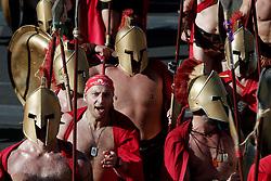 November 13, 2016 - Athens, Attica, Greece - Runners dressed as ancient Spartans warriors cross the finish line of the 34th Athens Classic Marathon, at the Panathenaic stadium in Athens, Greece, on Sunday November 13, 2016. (Credit Image: © Panayiotis Tzamaros/NurPhoto via ZUMA Press)