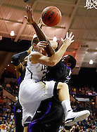 SOUTH BEND, IN - DECEMBER 21: Pat Connaughton #24 of the Notre Dame Fighting Irish and Devon White #2 of the Niagara Purple Eagles collide under the basket at Purcel Pavilion on December 21, 2012 in South Bend, Indiana. (Photo by Michael Hickey/Getty Images) *** Local Caption *** Pat Connaughton; Devon White