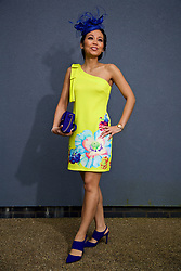 LIVERPOOL, ENGLAND - Thursday, April 6, 2017: Nok Srikaew, 30, from Thailand, wearing a dress from Asos and bag and shoes from New Look, during The Opening Day on Day One of the Aintree Grand National Festival 2017 at Aintree Racecourse. (Pic by David Rawcliffe/Propaganda)