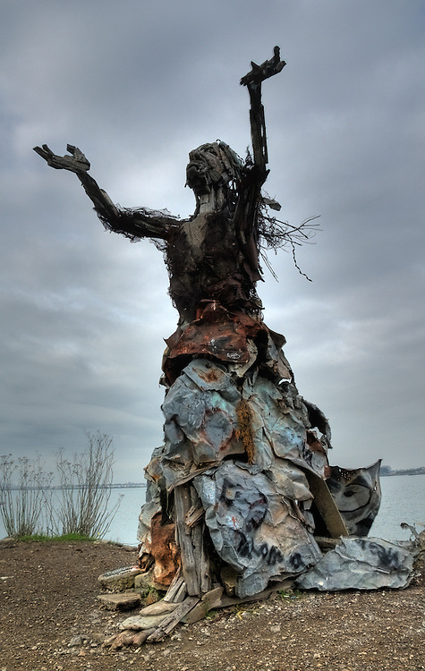 Sculpture of a woman with arms raised, at the Albany Bulb, constructed from recycled materials and found objects on the site of a former landfill.