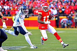 Jan 19, 2020; Kansas City, Missouri, USA; Kansas City Chiefs wide receiver Mecole Hardman (17) runs the ball against Tennessee Titans defensive back Tramaine Brock (35) during the first half in the AFC Championship Game at Arrowhead Stadium. Mandatory Credit: Denny Medley-USA TODAY Sports