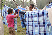 TAI\'AN, CHINA - SEPTEMBER 11:<br /> Student's parents dry their children's quilts and sheets in the air at a square in Taishan University on September 11, 2016 in Tai\'an, Shandong Province of China. As new semester started around early September, many students and their parents dried quilts and sheets in the air at Taishan University in Tai\'an. <br /> ©Exclusivepix Media