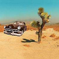 Desert scene with edited 1950's classic car in USA