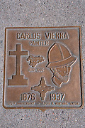 Bronse sidewalk plaque commemorating painter Carolos Vierra, Old Town Santa Fe, New Mexico