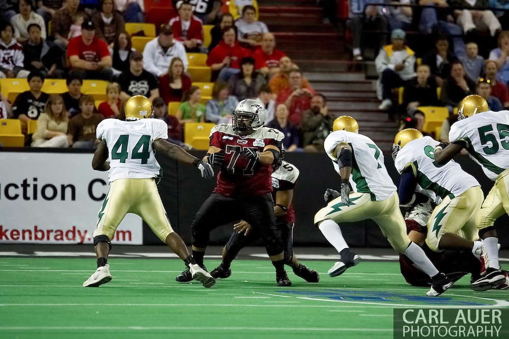 4/12/2007 - Leuma Pua'auli tries to make a hole in the Frisco Thunder Defense as the Alaska Wild would drop their home opener 33-46 to the Frisco Thunder in the first professional football game in Alaska.