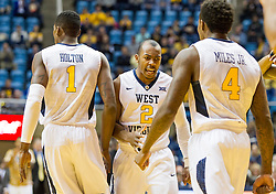 Nov 13, 2015; Morgantown, WV, USA; West Virginia Mountaineers guard Jevon Carter (2) celebrates with forward Jonathan Holton (1) and guard Daxter Miles Jr. (4) after a made basket against the Northern Kentucky Norse during the first half at WVU Coliseum. Mandatory Credit: Ben Queen-USA TODAY Sports