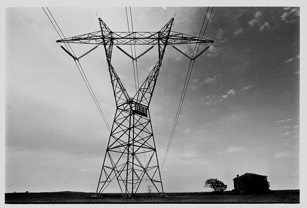 Teruel ,Spain. An electrical line across the field.©Carmen Secanella