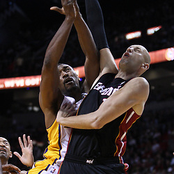 March 10, 2011; Miami, FL, USA; Los Angeles Lakers small forward Ron Artest (15) shoots over Miami Heat center Zydrunas Ilgauskas (11) during the first quarter at the American Airlines Arena.  Mandatory Credit: Derick E. Hingle