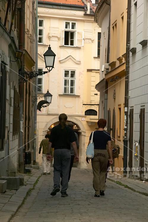 Europe, Slovakia, capitol city - Bratislava. Zamocnicka Street curves around from the Michael tower toward the town square..