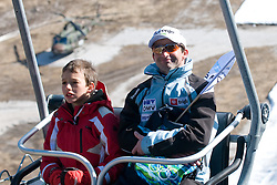 Franci Petek with his son on a ski lift before Flying Hill Individual Final Round at 4th day of FIS Ski Jumping World Cup Finals Planica 2011, on March 20, 2011, Planica, Slovenia. (Photo By Matic Klansek Velej / Sportida.com)