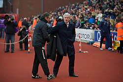 STOKE-ON-TRENT, ENGLAND - Sunday, January 4, 2015: Stoke City's manager Mark Hughes and Wrexham's manager Kevin Wilkin before the FA Cup 3rd Round match at the Britannia Stadium. (Pic by David Rawcliffe/Propaganda)