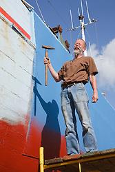 Man repairing fishing boat