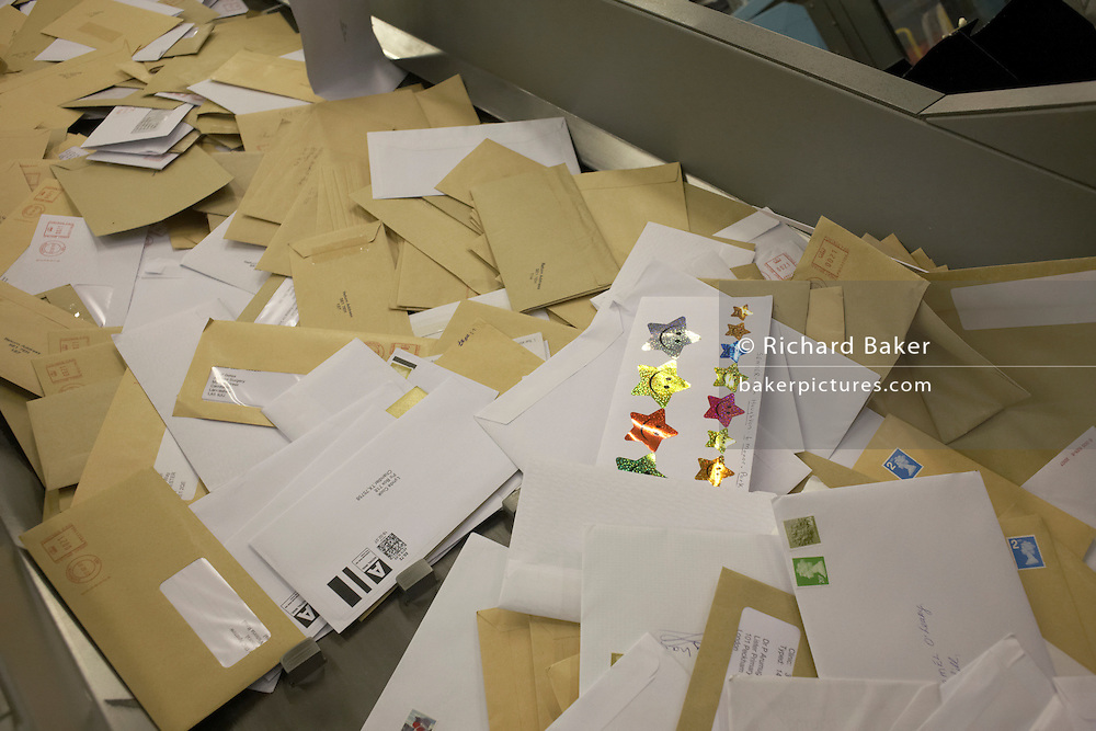 Letters about to be sorted by the Royal Mail operated Siemens Integrated Mail Processor operated at Nine Elms sorting office