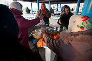 Women haggle over the price of fresh homemade cottage cheese at an outdoor market in Hoiniki on Oct. 25, 2009.