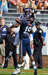 Virginia cornerback Ras-I Dowling (19) breaks up a pass intended for East Carolina wide receiver T.J. Lee (7).  The Virginia Cavaliers defeated the East Carolina Pirates 35-20 in NCAA football at Scott Stadium on the Grounds of the University of Virginia in Charlottesville, VA on October 11, 2008.