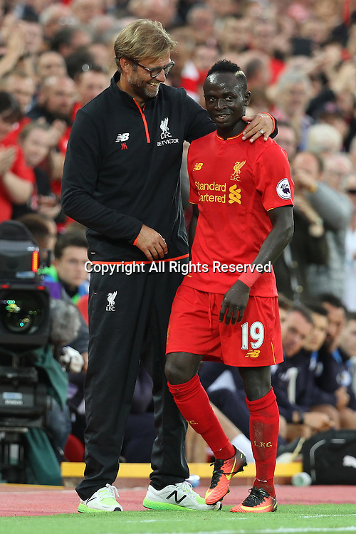 10.09.2016. Anfield, Liverpool, England. Premier League Football. Liverpool versus Leicester. Jurgen Klopp, Liverpool manager congratulates Sadio Mane of Liverpool on his performance.