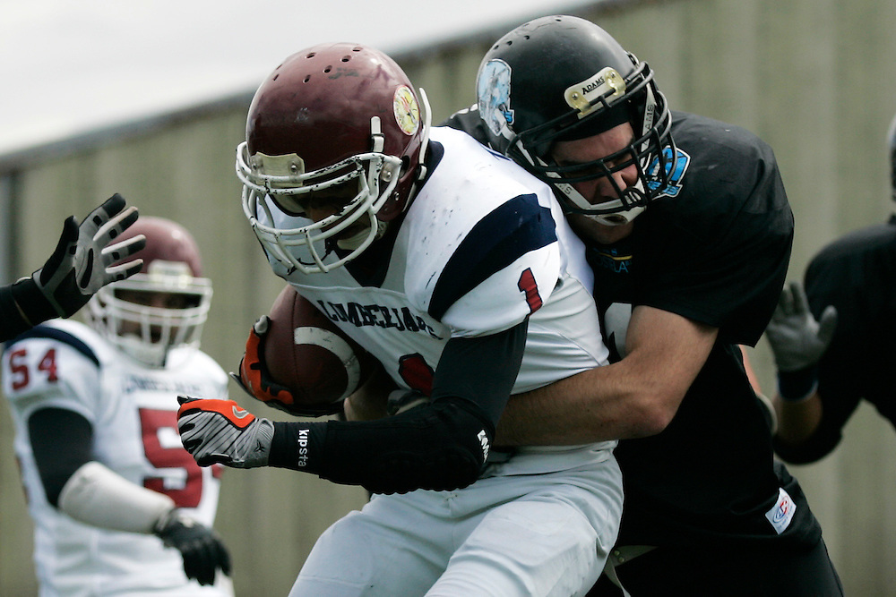 """(Santiago de Compostela, Spain - April 18, 2010) - The Galicia Black Towers beat the Oporto Lumberjacks 34-19 and clinch a playoff spot in their inaugural season. Quarterback David Siso threw five touchdown passes and connected with running back Pablo """"Mexi"""" Benavent for three of them..Photo by Will Nunnally / Will Nunnally Photography"""