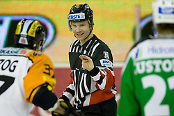 Referee shows Stefan Herzog (Moser Medical Graz99ers, #37) that he was faking penalty during ice-hockey match between HDD Tilia Olimpija and Moser Medical Graz99ers in 10th Round of EBEL league, on October 10, 2010 at Hala Tivoli, Ljubljana, Slovenia. (Photo By Matic Klansek Velej / Sportida.com)