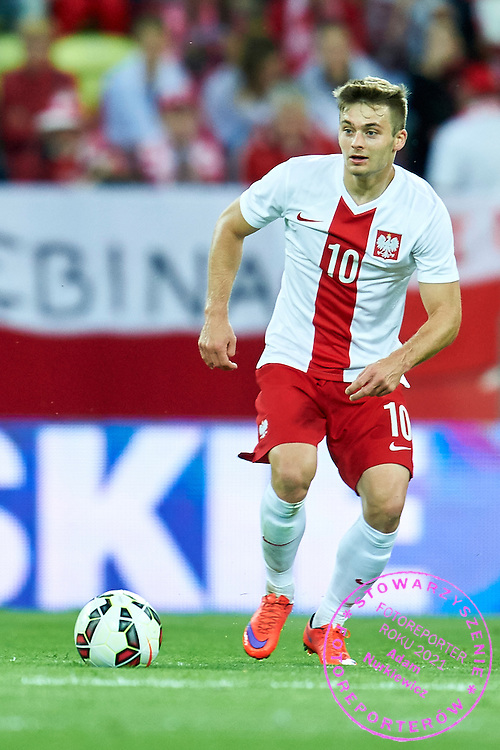 Karol Linetty from Poland controls the ball during international friendly soccer match between Poland and Greece at PGE Arena Stadium on June 16, 2015 in Gdansk, Poland.<br /> Poland, Gdansk, June 16, 2015<br /> <br /> Picture also available in RAW (NEF) or TIFF format on special request.<br /> <br /> For editorial use only. Any commercial or promotional use requires permission.<br /> <br /> Adam Nurkiewicz declares that he has no rights to the image of people at the photographs of his authorship.<br /> <br /> Mandatory credit:<br /> Photo by &copy; Adam Nurkiewicz / Mediasport