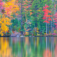 New England fall foliage reflection at White Lake State Park Tamworth, New Hampshire. <br />