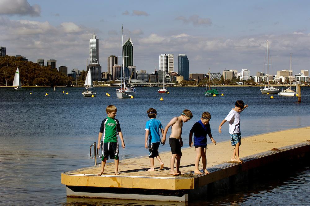 Children enjoying Perth's Swan River, Western Australia