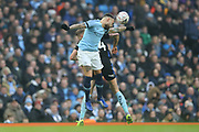 30 Nicolás Otamendi for Manchester City challenges r24	Rotherham United forward Michael Smith (24) during the The FA Cup 3rd round match between Manchester City and Rotherham United at the Etihad Stadium, Manchester, England on 6 January 2019.