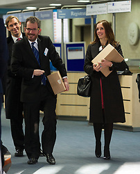© London News Pictures. 29/11/2012. London, UK. L to R Counsel to the Inquiry David Barr, Carine Patry Hoskins and  Robert  Jay Q.C leaving  the QEII centre in London carrying copies of the Leveson report following Lord Justice Leveson announcement about his report  into the culture and ethics of the UK's press. Photo credit: Ben Cawthra/LNP