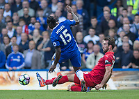 Football - 2016/2017 Premier League - Chelsea V Leicester.<br /> <br /> Christian Fuchs of Leicester City with timely tackle on Victor Moses of Chelsea at Stamford Bridge.<br /> <br /> COLORSPORT/DANIEL BEARHAM