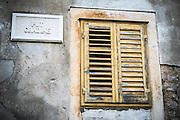 Window shutter and street sign, Skradin, Dalmatia, Croatia