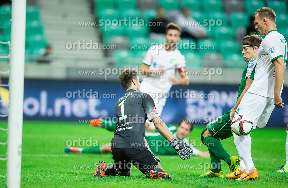 Aleksander Seliga #1 of Olimpija, Jure Petric #4 of Krsko and Dejan Kelhar #4 of Olimpija  during football match between NK Olimpija Ljubljana and NK Krsko in 13th Round of Prva liga Telekom Slovenije 2015/16, on October 4, 2015 in SRC Stozice, Ljubljana, Slovenia. Photo by Vid Ponikvar / Sportida