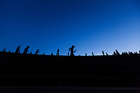 People jog and exercise in the late evening at the Olympic Stadium in Phnom Penh, Cambodia. The Olympic Stadium was built in 1964.