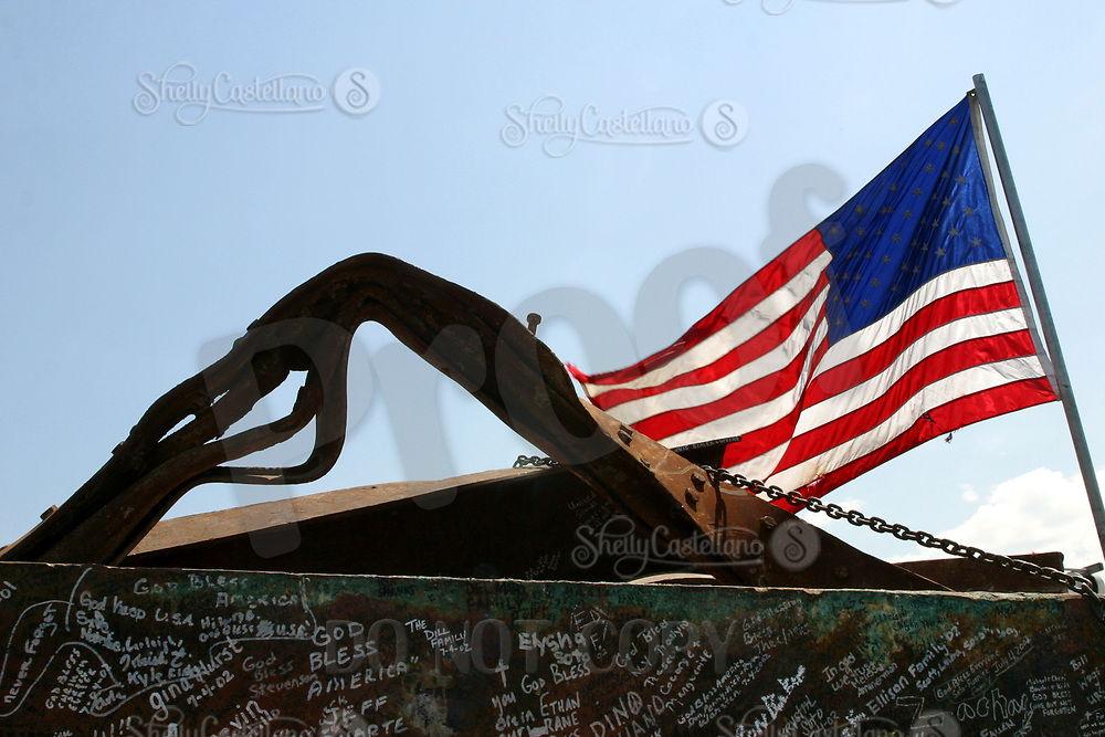 Sep 10, 2002; Yorba Linda, California, USA; American Flag rests ontop of an exhibit of 9/11 wreckage from the World Trade Center at the Richard Nixon Library &amp; Birthplace.<br />Mandatory Credit: Photo by Shelly Castellano/ZUMA Press.<br />(&copy;) Copyright 2002 by Shelly Castellano