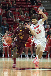 11 January 2014:  Milton Doyle hustles towards half court pressured by Kaza Keane during an NCAA  mens basketball game between the Ramblers of Loyola University and the Illinois State Redbirds  in Redbird Arena, Normal IL.  Redbirds win 59-50