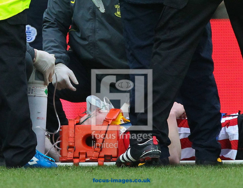 Matt Targett of Southampton is injured during the Barclays Premier League match at the Loftus Road Stadium, London<br /> Picture by John Rainford/Focus Images Ltd +44 7506 538356<br /> 07/02/2015