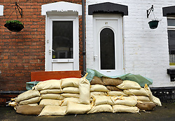 © Licensed to London News Pictures. 14/02/2014; Gloucester, UK.  Alney Terrace in Alney Island which is subject to a Severe Flood Warning, threatened by rising water levels from the nearby river Severn.  The residents have been given sandbags by Gloucestershire Council.<br /> Photo credit: Simon Chapman/LNP
